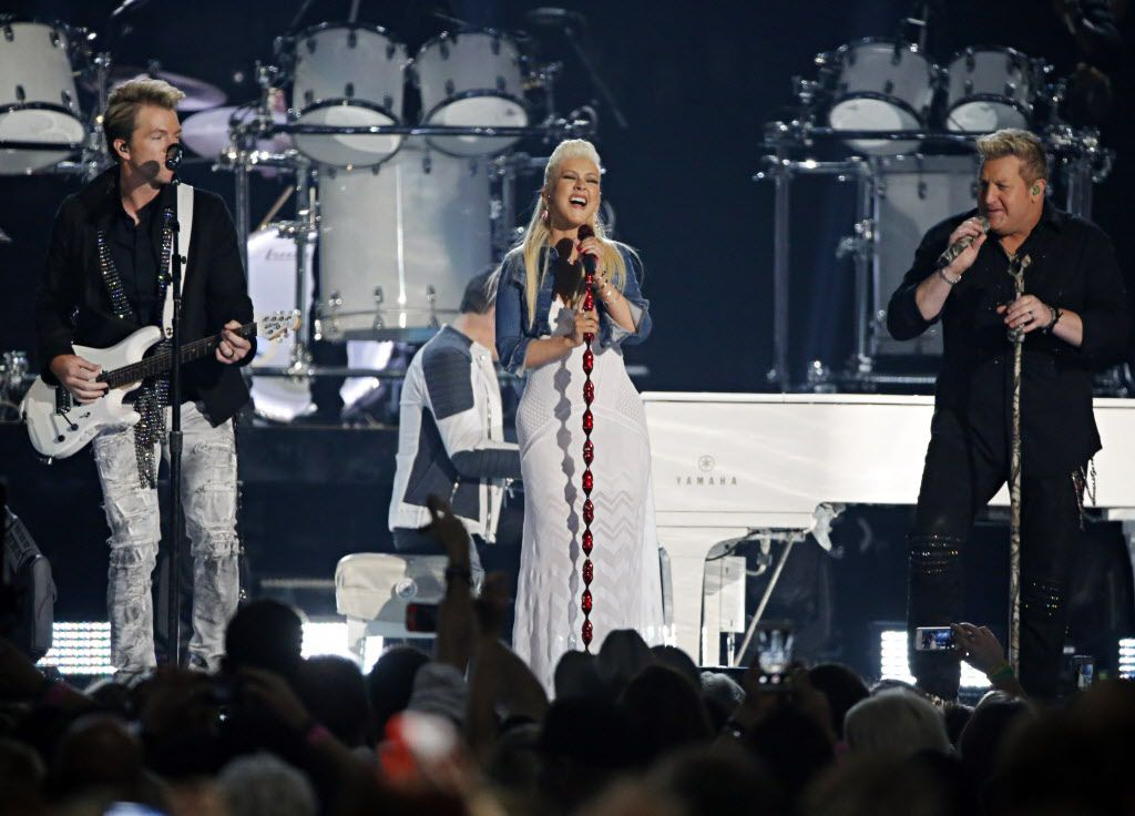 Christina Aguilera (center) performs with Rascal Flatts during the 2015 Academy of Country Music Awards Sunday, April 19, 2015 at AT&T Stadium in Arlington, Texas.
