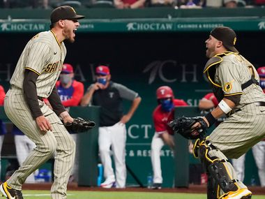 San Diego Padres starting pitcher Joe Musgrove celebrates with catcher Victor Caratini after the final out of a no-hitter over the Texas Rangers at Globe Life Field on Friday, April 9, 2021.