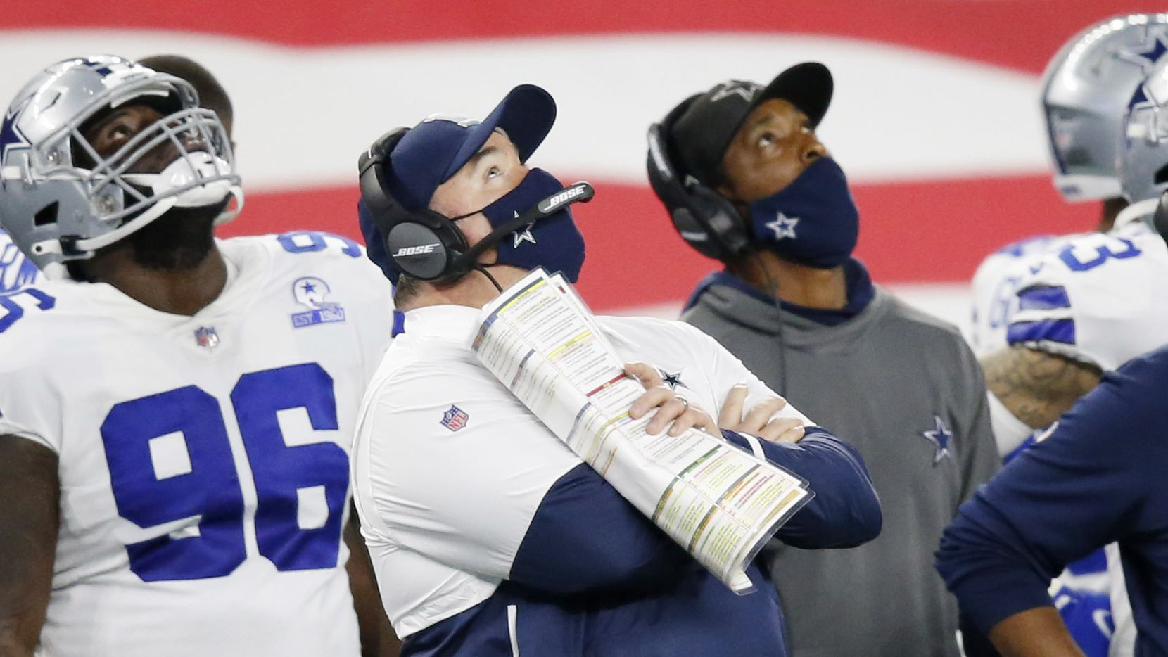 Dallas Cowboys head coach Mike McCarthy looks at the replay in a game against the Arizona Cardinals during the third quarter of play at AT&T Stadium on Monday, October 19, 2020 in Arlington, Texas.