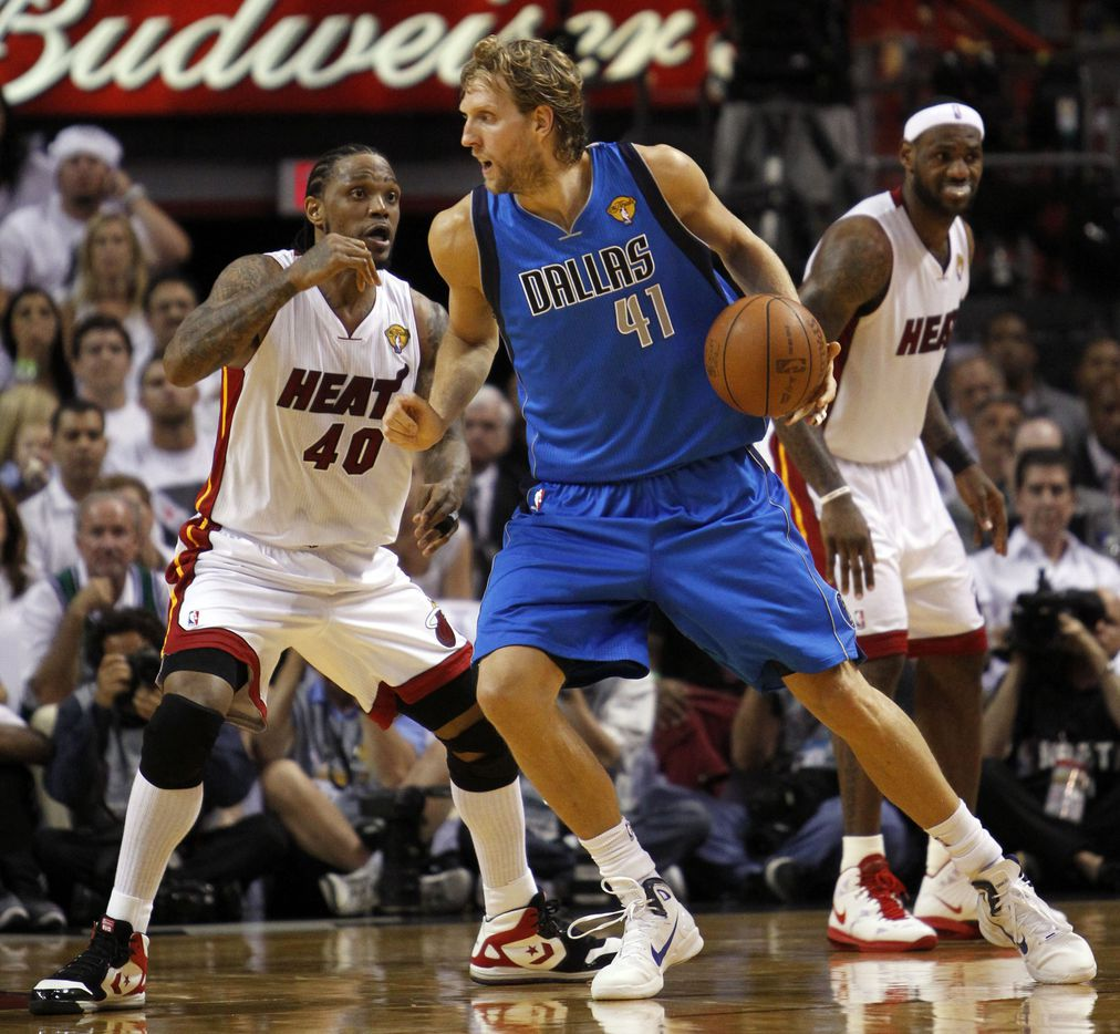 Dallas Mavericks power forward Dirk Nowitzki (41) drives on Miami Heat power forward Udonis Haslem (40) during the third quarter of play in game six of the NBA Finals at American Airlines Arena Sunday, June 12, 2011 in Miami   (Tom Fox/The Dallas Morning News) 07202011xSPORTS
