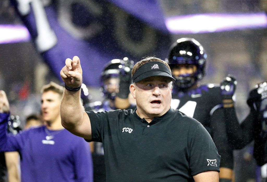 TCU Horned Frogs head coach Gary Patterson participates in the school song following their loss to the West Virginia Mountaineers at Amon G. Carter Stadium in Fort Worth, Friday, November 29, 2019. The Horned Frogs lost, 20-17. (Tom Fox/The Dallas Morning News)