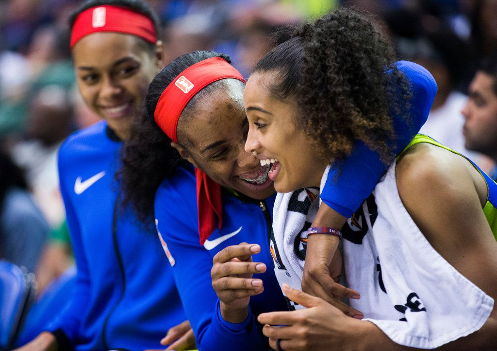 Dallas Wings forward Kayla Thornton (6) hugs Dallas Wings guard Skylar Diggins-Smith (4) on the bench during the fourth quarter of a WNBA game between the Dallas Wings and the Indiana Fever on Thursday, July 5, 2018 at UTA's College Park Center in Arlington, Texas.