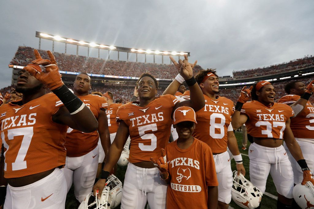 AUSTIN, TX - SEPTEMBER 22:  Tre Watson #5 of the Texas Longhorns celebrates with teammates after the game against the TCU Horned Frogs at Darrell K Royal-Texas Memorial Stadium on September 22, 2018 in Austin, Texas.  (Photo by Tim Warner/Getty Images)