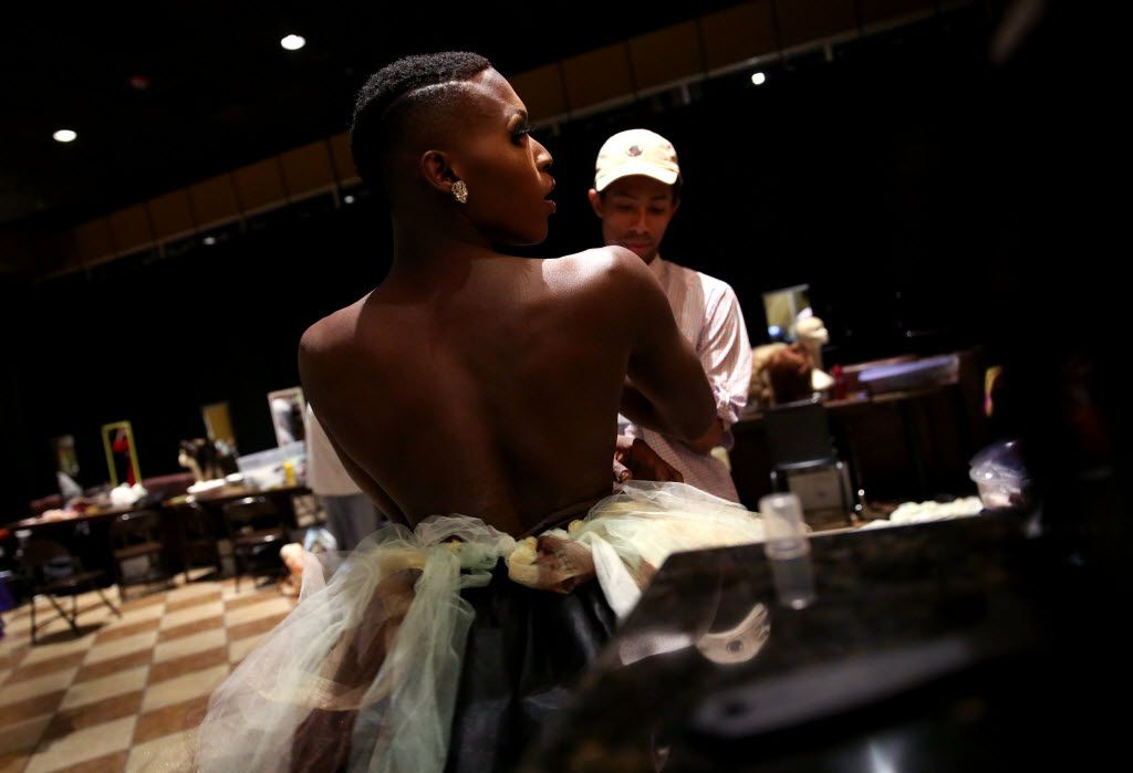 Athena O'Hara looks in the mirror while putting on her dress during the Miss Gay Texas America preliminary round at Station 4 in Dallas on Wednesday, July 20, 2016 (Rose Baca/The Dallas Morning News)