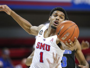 SMU forward Feron Hunt (1) reaches for a rebound during the second half of a college basketball game against Memphis in Dallas, Thursday, January 28, 2021. SMU won 67-65. (Brandon Wade/Special Contributor)