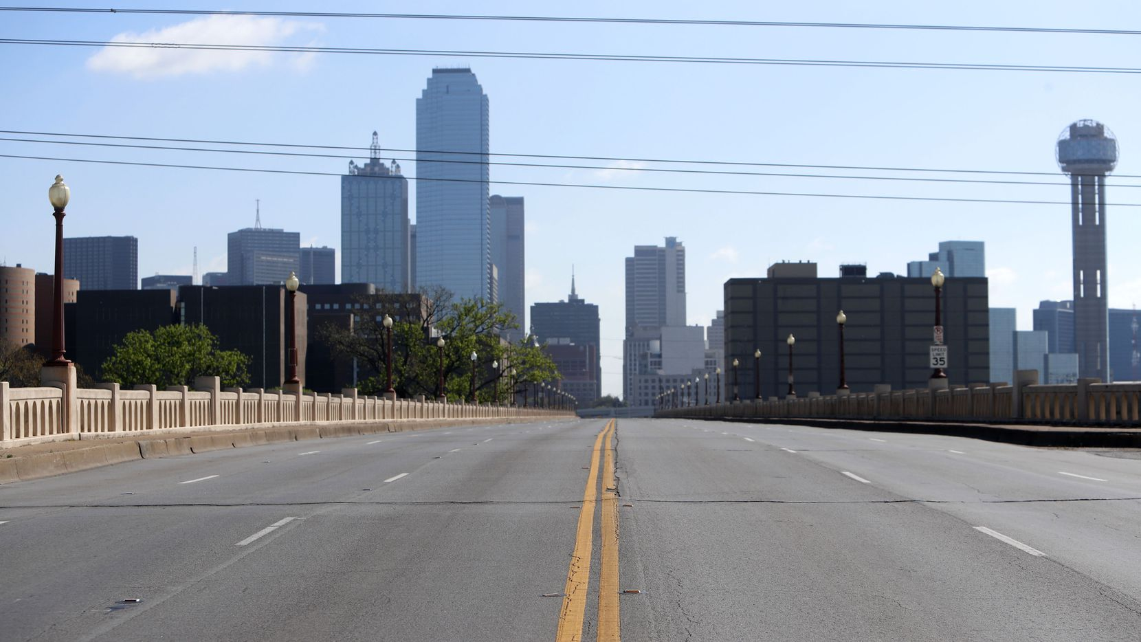 With Dallas County under a shelter in place order due to the COVID-19 disease, a normally busy road sits empty leading into downtown Dallas on March 24.
