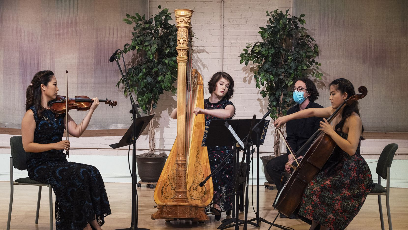 Presented by Fine Arts Chamber Players, violinist Julia Choi, harpist and artistic director Emily Levin, and cellist Jennifer Choi record Henriette Renié's Trio for Harp, Violin and Cello at the Sammons Center for the Arts in Dallas, on April 21.