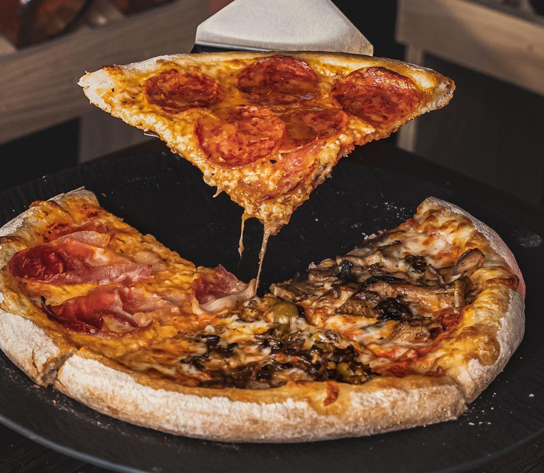 Italian Village serves familiar Italian fare like pizza and pasta.