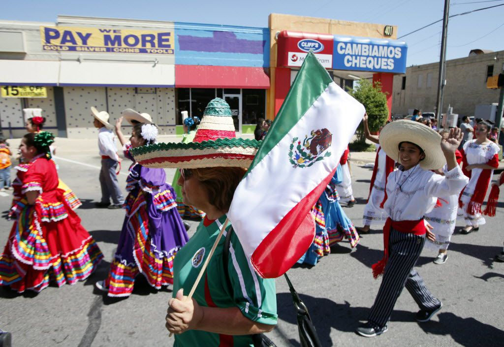 Gloria Reyes walks with a sombrero and Mexican flag during the 24th Annual Cinco de Mayo parade and festival on Jefferson Boulevard in 2014.