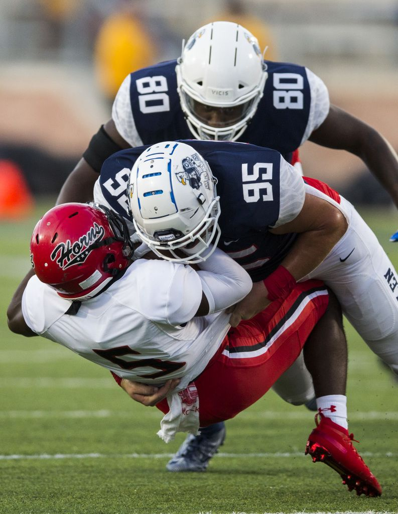 Cedar Hill running back Kevin Young (5) is tackled by Allen defensive lineman Elijah Fisher (95) and Tommy Nance (80) during the first quarter of a high school football game between Allen and Cedar Hill on Friday, August 30, 2019 at Eagle Stadium in Allen. (Ashley Landis/The Dallas Morning News)