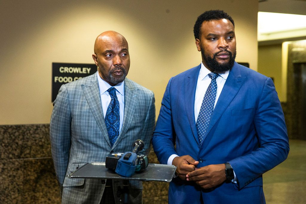 Jean family attorneys Daryl K. Washington (left) and Lee Merritt spoke to the media at the Frank Crowley Courts Building in Dallas on Monday.