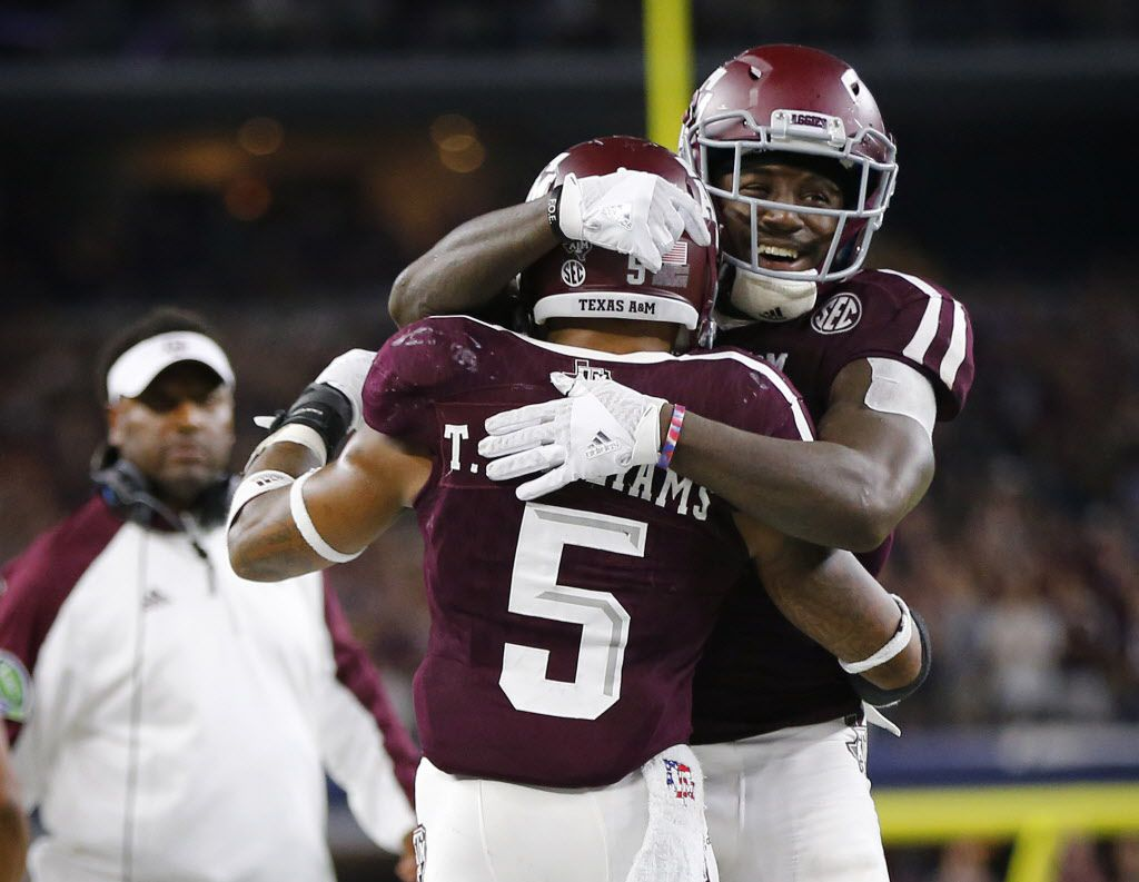 Texas A&M Aggies running back Keith Ford (7) congratulates running back Trayveon Williams (5) on his the second half touchdown against the Arkansas Razorbacks in the Southwest Classic at AT&T Stadium in Arlington, Texas, Saturday, September 24, 2016. Texas A&M won, 45-24. (Tom Fox/The Dallas Morning News)