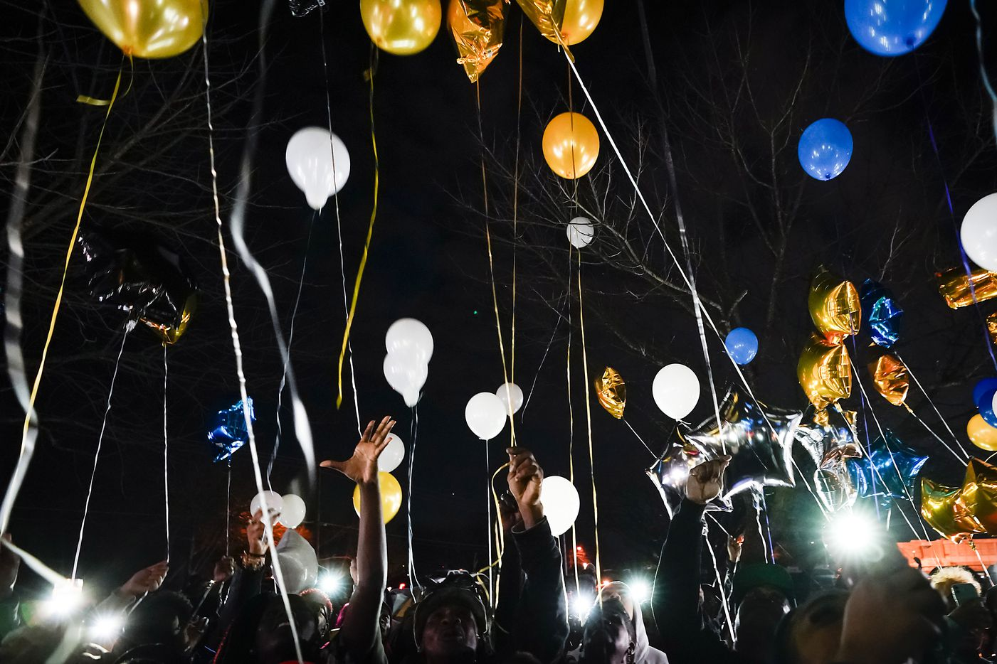 """Mourners release balloons during a vigil for Marc """"Flea"""" Strickland, an 18-year-old victim of a shooting at Dallas ISD basketball game, at Bushman Park on Sunday, Jan. 19, 2020."""