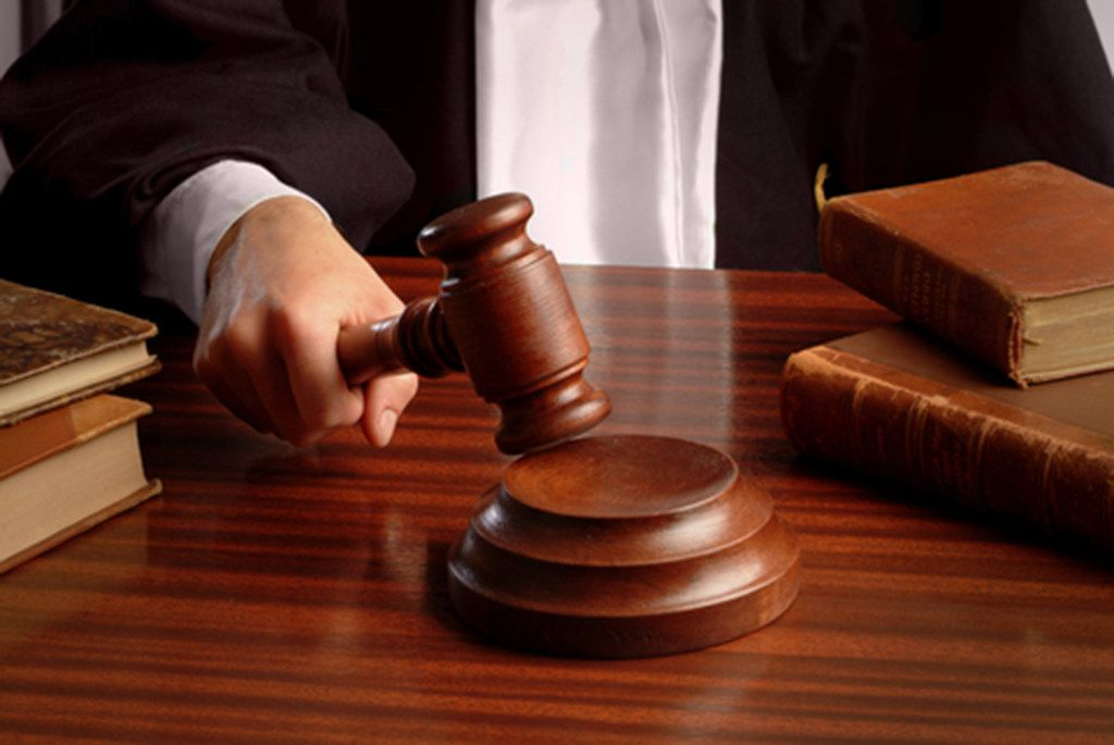 Judge hand with gavel (Dreamstime/TNS)