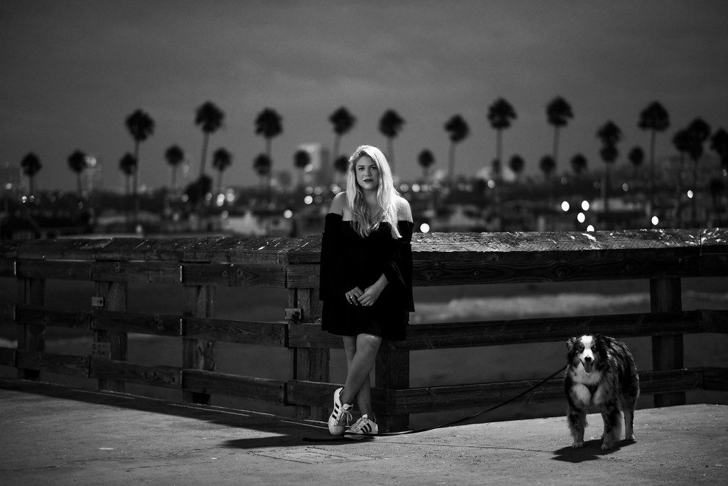 Terra Newell and her dog, Cash, at the Balboa Pier in Newport Beach, Calif., on September 8, 2017. (Christina House/Los Angeles Times/TNS)