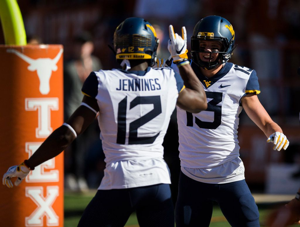West Virginia Mountaineers wide receiver Gary Jennings Jr. (12) and wide receiver David Sills V (13) celebrate a touchdown during the first quarter of a college football game between the University of Texas and West Virginia on Saturday, November 3, 2018 at Darrell Royal Memorial Stadium in Austin, Texas. (Ashley Landis/The Dallas Morning News)