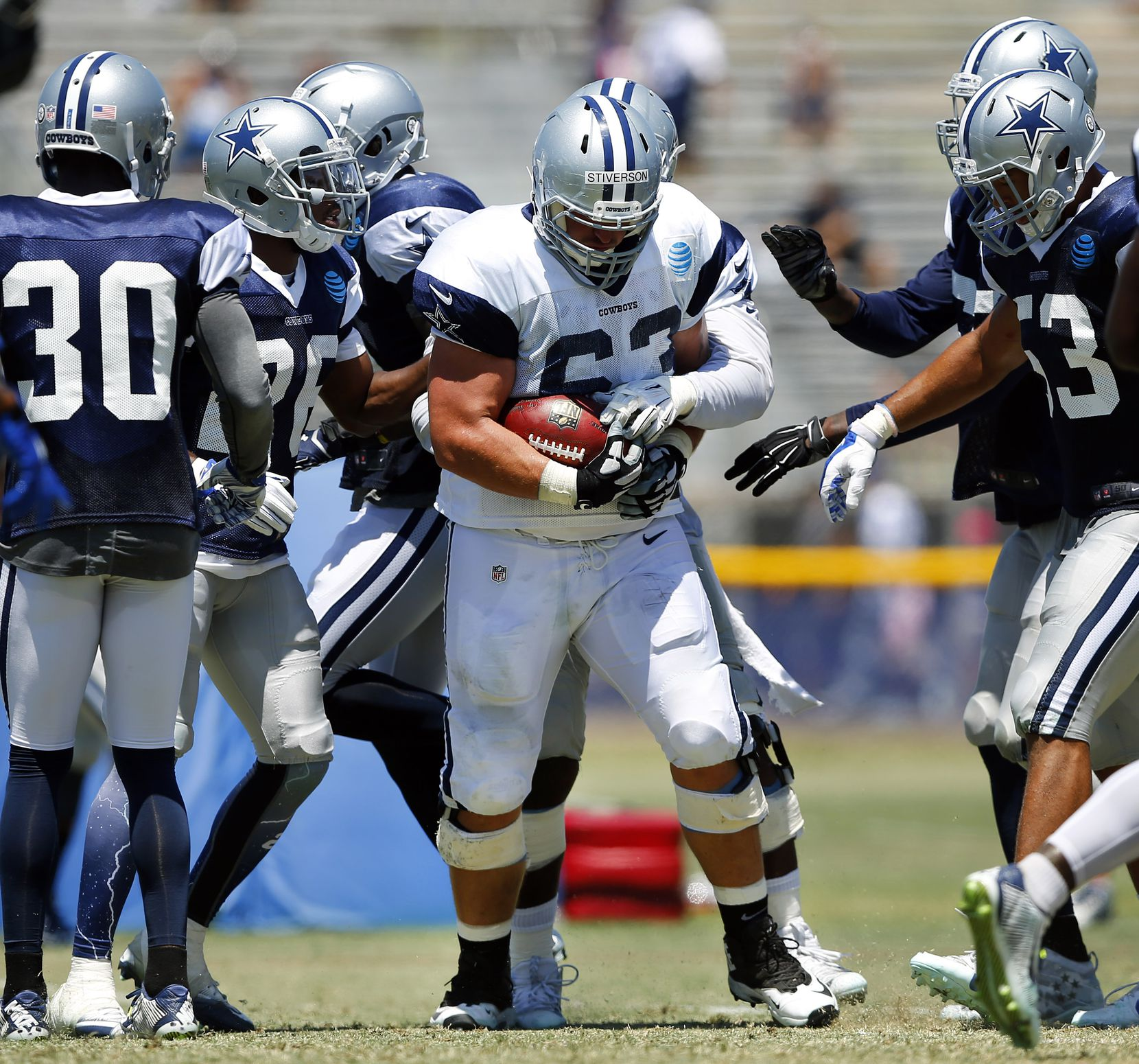 Dallas Cowboys offensive guard Boston Stiverson (63) finds the ball in his hands after a tipped pass at the line of scrimmage during morning practice at training camp in Oxnard, California, Thursday, August 11, 2016. (Tom Fox/The Dallas Morning News)