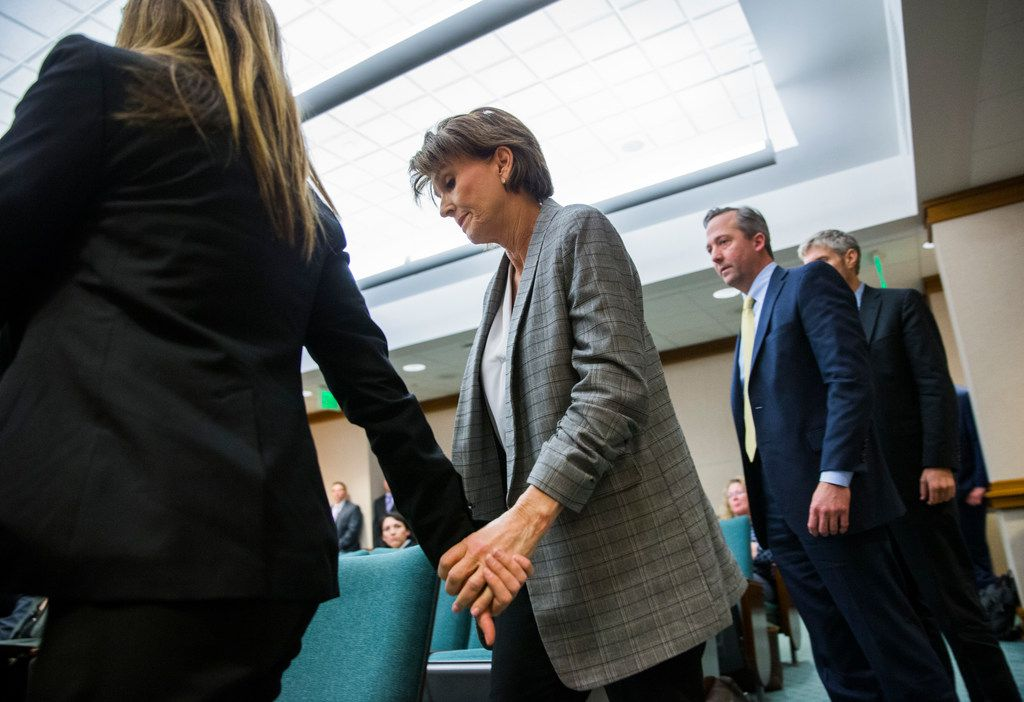 Eve Wiley (left) and her mother, Margo Williams walk to the front of the room to testify before the Senate Criminal Justice Committee in April. Wiley's lobbyists/advisers, Kris Heckmann and Justin Keener (partially obscured), are at right.