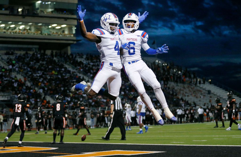Duncanville wide receiver Zeriah Beason (4) is congratulated by his teammate Marquelan Crowell (6) after he caught a second quarter touchdown against Lancaster at Beverly D. Humphrey Tiger Stadium in Lancaster Texas, Friday, August 30, 2019. (Tom Fox/The Dallas Morning News)