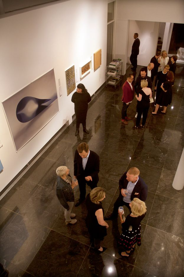 Guests mingle at the TWO x TWO preview party inside the Rachofsky House