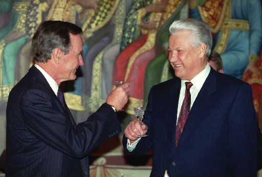 """President George Bush and Russian President Boris Yeltsin raised a toast to """"our New Year's gift to the people of the world,"""" referring to the signing of the START II arms reduction treaty, at the Kremlin in January 1993. (File Photo/The Associated Press)"""