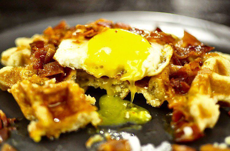 The American, a Belgian liege waffle with bacon, syrup and a fried egg.