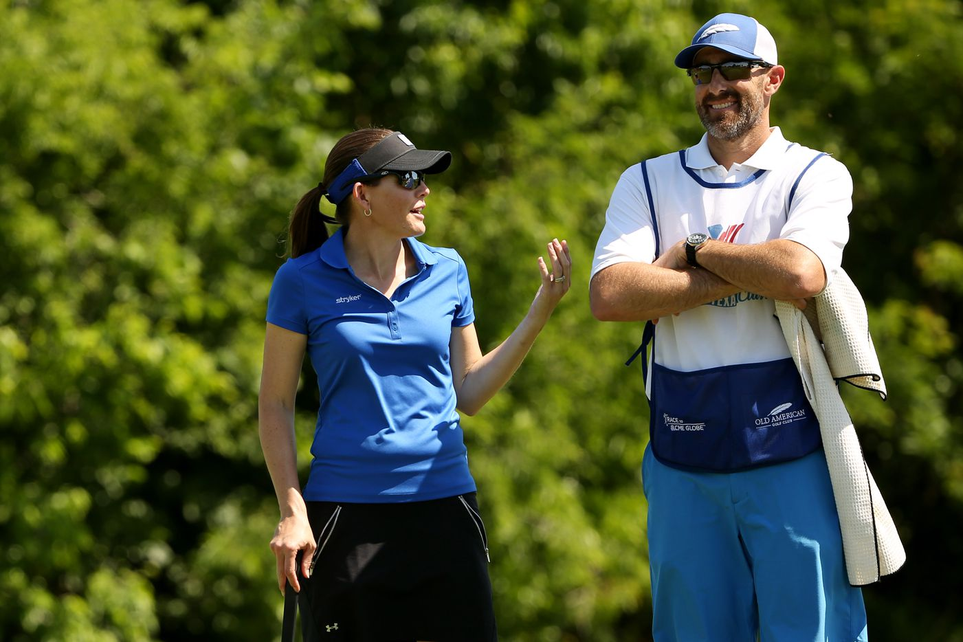 Stephanie Louden, of Frisco, Texas, speaks to her husband, Mike Louden, who is also her caddy, on the 17th green during round one of the 36-hole revised Volunteers of America LPGA North Dallas Classic.