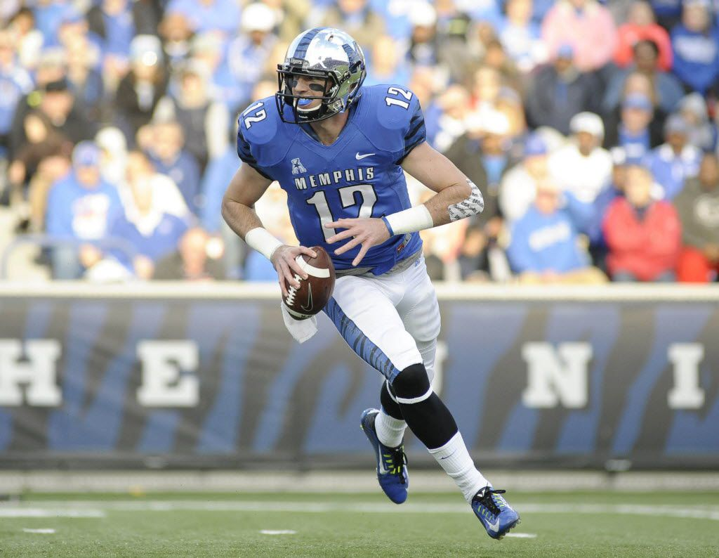 Nov 29, 2014; Memphis, TN, USA; Memphis Tigers quarterback Paxton Lynch (12) runs with the ball against the Connecticut Huskies during the game at Liberty Bowl Memorial Stadium. Mandatory Credit: Justin Ford-USA TODAY Sports