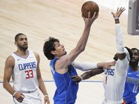 Dallas Mavericks center Boban Marjanovic (51) scores past LA Clippers guard Reggie Jackson (1) during the first quarter of an NBA playoff basketball game at the American Airlines Center on Friday, June 4, 2021, in Dallas.