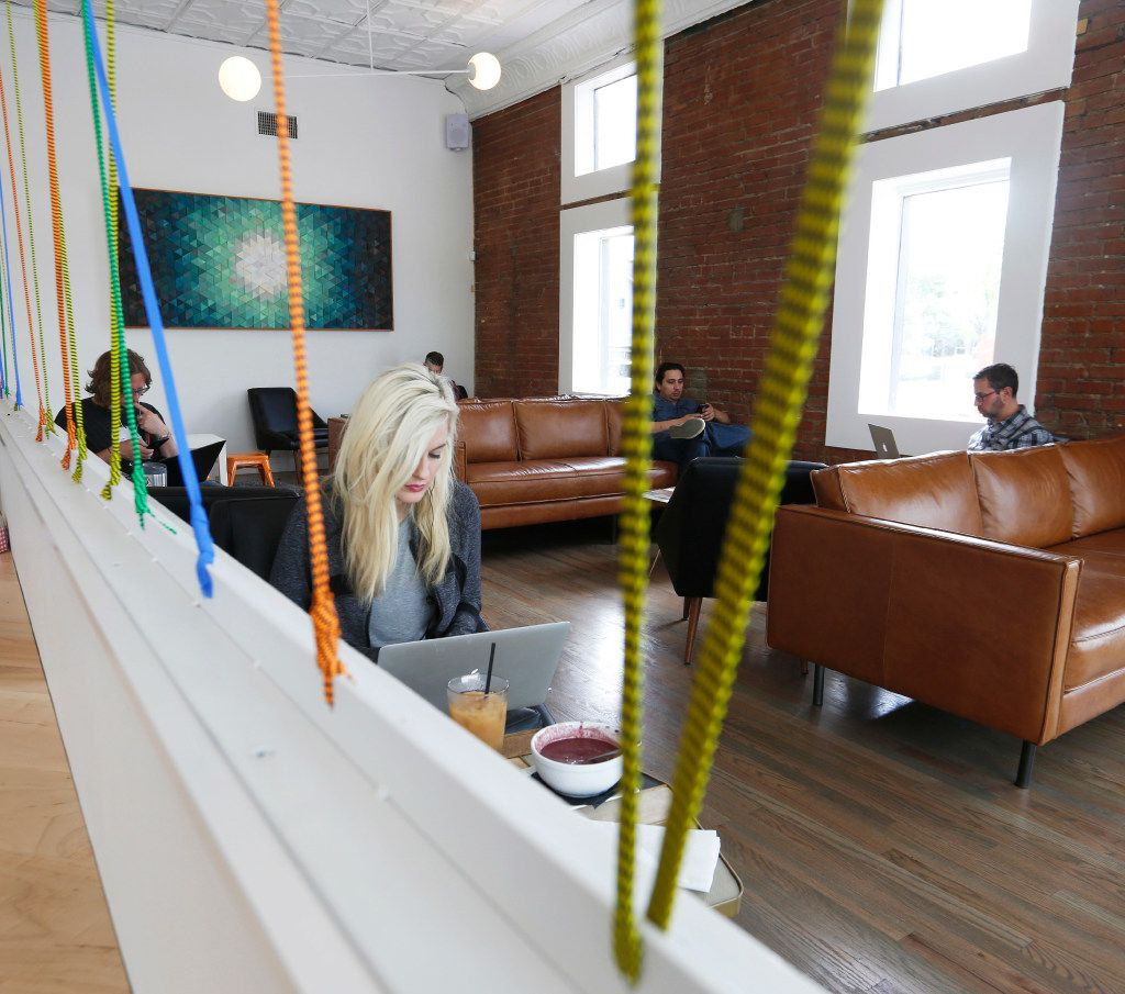 Designer Chandler Mann, foreground, works in the lounge area of the Halcyon Coffee Bar and Lounge Tuesday  March 28, 2017. The new coffee bar and lounge is located at 2900 Greenville Ave. in Dallas. (Ron Baselice/The Dallas Morning News)