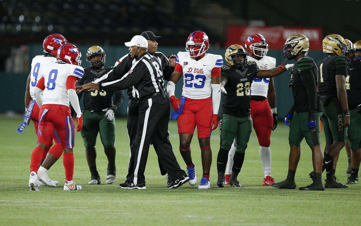 Referees separate Duncanville and DeSoto players after a skirmish between plays during the first half of a Class 6A Division I Region II final high school football game, Saturday, January 2, 2021.  Duncanville won 56-28. (Brandon Wade/Special Contributor)