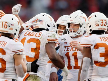 FILE - Texas wide receiver Brennan Eagles (13) celebrates with quarterback Sam Ehlinger (11) after catching a 14-yard touchdown pass during the first half of a game against Iowa State on Saturday, Nov. 16, 2019, in Ames, Iowa. (AP Photo/Charlie Neibergall)