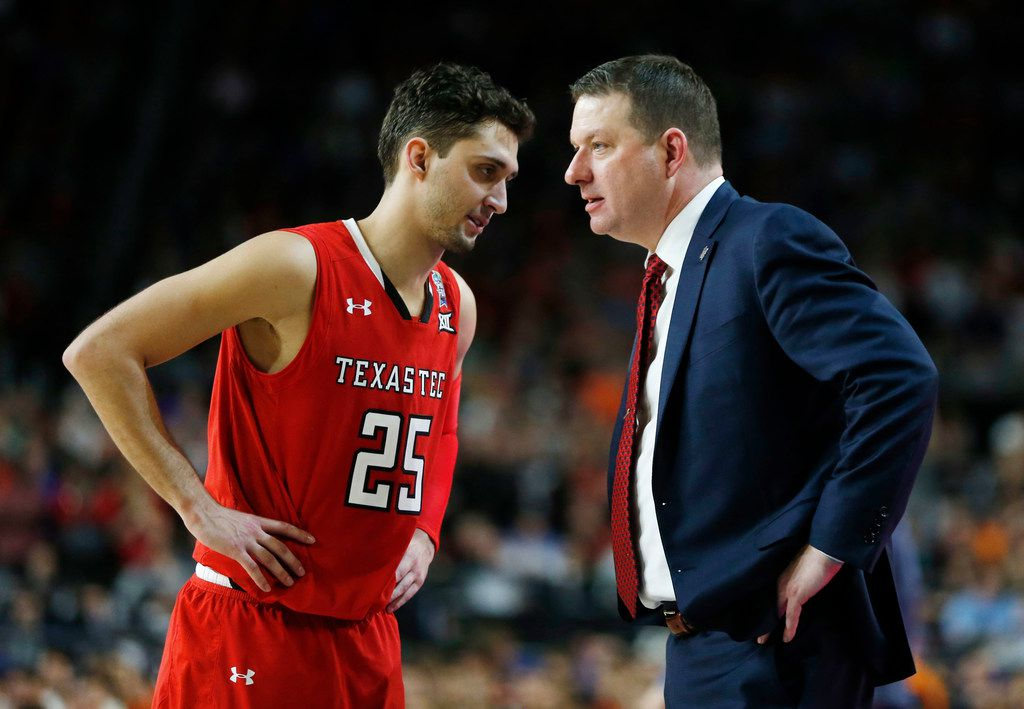 Texas Tech Red Raiders guard Davide Moretti (25) and Texas Tech Red Raiders head coach Chris Beard talk during a break in play in the second half of play in the Final Four championship game of the NCAA men's college basketball tournament at U.S. Bank Stadium in Minneapolis on Monday, April 8, 2019. Texas Tech Red Raiders lost to the Virginia Cavaliers 85-77 in overtime.