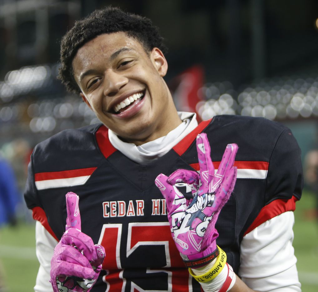 Cedar Hill receiver Javien Clemmer (13) was all smiles as he gestures his jersey number after pulling in the game winning touchdown pass during overtime to give Cedar Hill a 27-24 victory over Rockwall Heath to advance. The two teams played their Class 6A Division l Region ll final football playoff game at Globe Life Park in Arlington on January 2, 2021. (Steve Hamm/ Special Contributor)