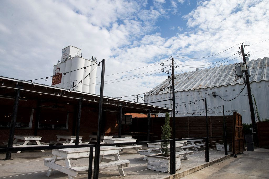 Carrollton says the $1 million in grants being offered to 3 Nations Brewing to remodel the unused grain storage building (right) will bring more life to its historic downtown area.