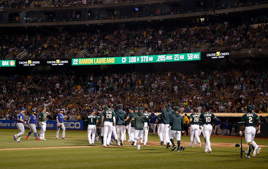 OAKLAND, CALIFORNIA - JULY 27: Texas Rangers and Oakland Athletics benches clear after Ramon Laureano #22 of the Oakland Athletics was hit by a pitch in the bottom of the eighth inning at Ring Central Coliseum on July 27, 2019 in Oakland, California. (Photo by Lachlan Cunningham/Getty Images)