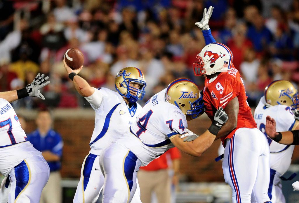 FILE - Tulsa quarterback G.J. Kinne throws a pass that would be tipped by SMU defensive lineman Marquis Frazier (9) during the first half of a game at Gerald J. Ford Stadium. Mandatory Credit: Mark J. Rebilas-US PRESSWIRE