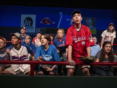 """(Front row from left) Ryan Doty as Johnny, Paul O'Gorman as Scott, Mason Johnston as Shane, Dillon Clement as Nick, and Courtney Zorich as Mallorie, reenact the crowd during the 2011 Rangers versus Red Sox game during dress rehearsal the school's play """"One Strike Away"""" on Wednesday, Oct. 6, 2021, at Keller High School in Keller."""