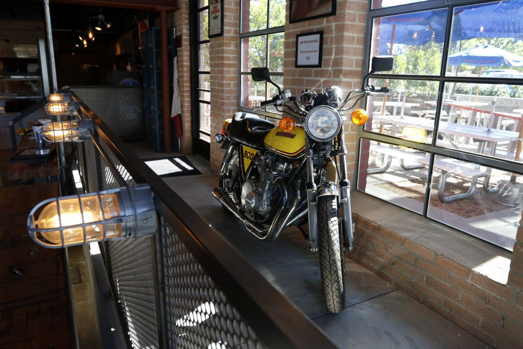 A motorcycle sits on display inside Off-Site Kitchen's new location in Trinity Groves in Dallas