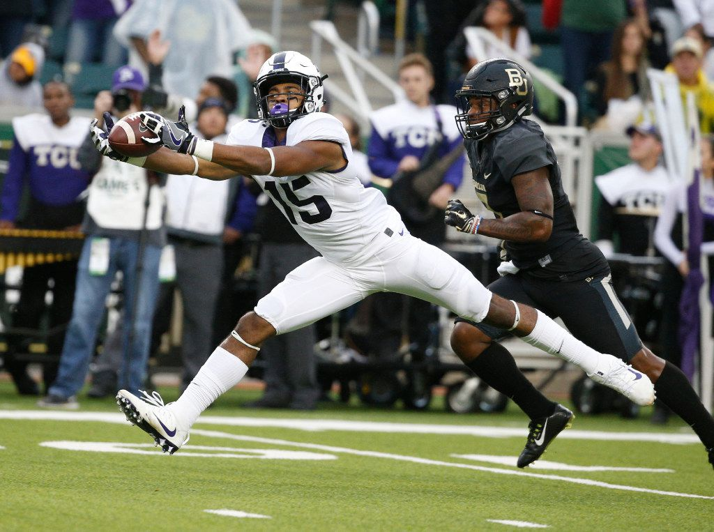 TCU Horned Frogs wide receiver Jaelan Austin (15) stretches for a catch against the Baylor Bears in the second quarter at McLane Stadium in Waco, Texas on Nov. 5, 2016.  TCU was leading 38-14 at the half. (Nathan Hunsinger/The Dallas Morning News)