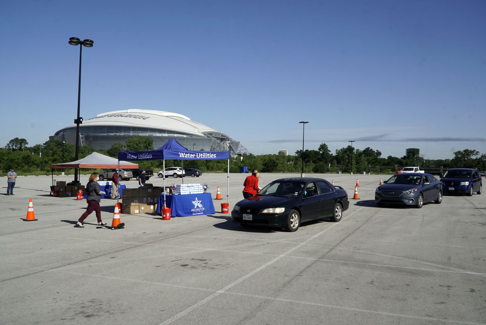 The City of Arlington in partnership with Tarrant County, the Texas Rangers, Greater Arlington Chamber of Commerce, and Arlington Convention and Visitors Bureau provided protective masks for free to employees in the parking lot of Globe Life Park in Arlington businesses and restaurants in Arlington, Texas on Wednesday, May 6, 2020.