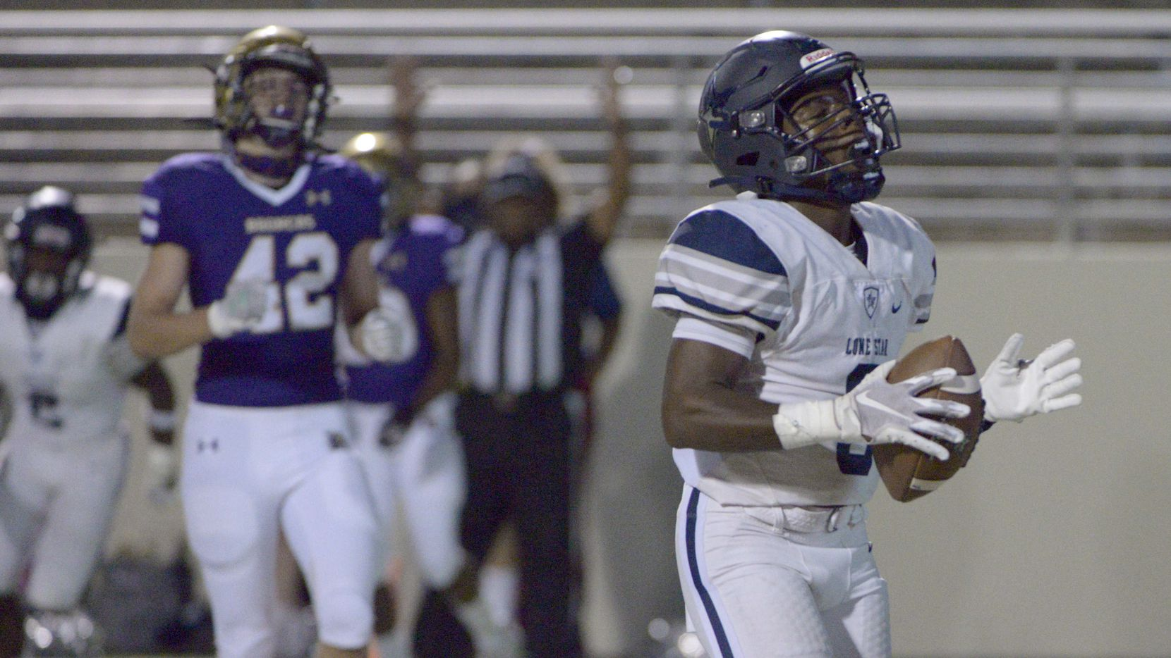 Lone Star's Tolu Sokoya (3) reacts after his touchdown catch in the first quarter of a high school football game between Frisco Lone Star and Denton, Thursday, Nov. 5, 2020, in Denton, Texas.