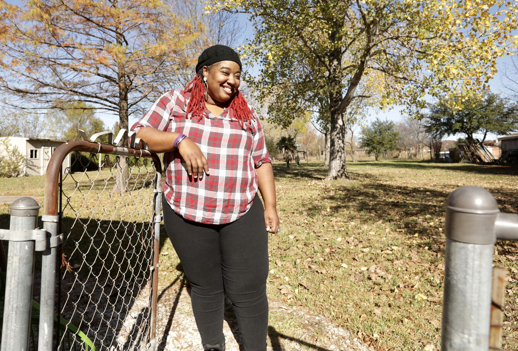 Jovon Humphrey poses for a photograph near the area where she recently saw a mountain lion jump the fence at her home in Rowlett, TX, on Nov. 30, 2020.  Jason Janik (special contributor)