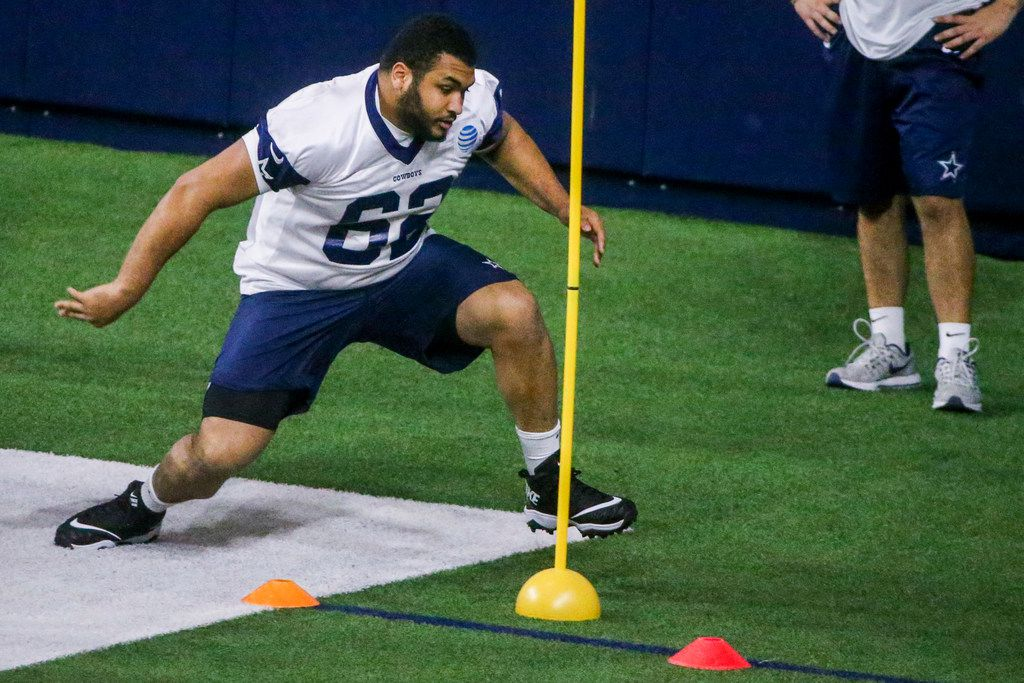 Dallas Cowboys offensive lineman Larry Allen Jr. runs a drill during the Cowboys rookie minicamp practices at The Star in Frisco, Texas on Saturday, May 11, 2019.(Shaban Athuman/Staff Photographer)