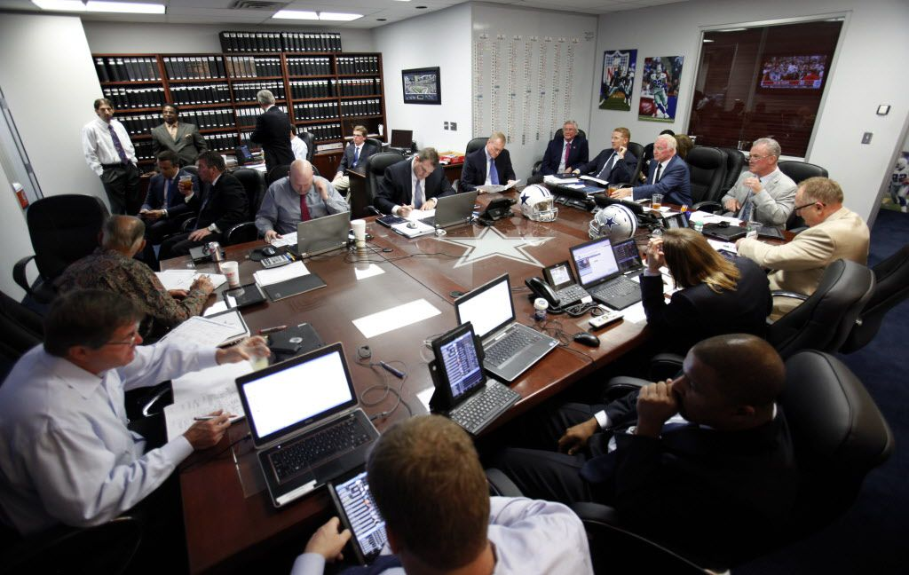 Dallas Cowboys head coach Jason Garrett, Cowboys owner and general manager Jerry Jones, Cowboys executive vice president Stephen Jones and others watch the TV's in the war room during the first round of the NFL draft at Dallas Cowboys headquarters at Valley Ranch in Irving  on April 25, 2013. (Vernon Bryant/The Dallas Morning News)