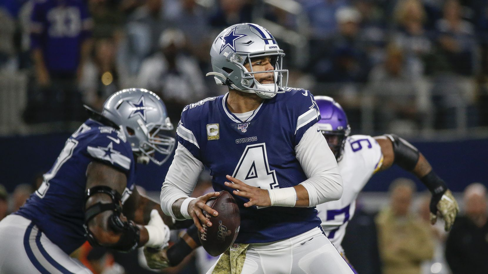 Dallas Cowboys quarterback Dak Prescott (4) fires off a pass during the first quarter of an NFL football game between the Dallas Cowboys and the Minnesota Vikings at AT&T Stadium in Arlington, Texas, on Sunday, Nov. 10, 2019.