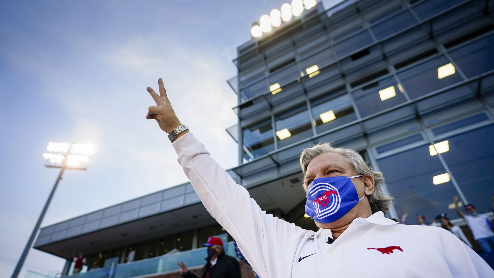 SMU fan Paul Layne stands for the playing of the school's alma mater before a game against Navy at Ford Stadium on Saturday, Oct. 31, 2020, in Dallas. Layne has been to 527 straight SMU football games dating back 48 years.