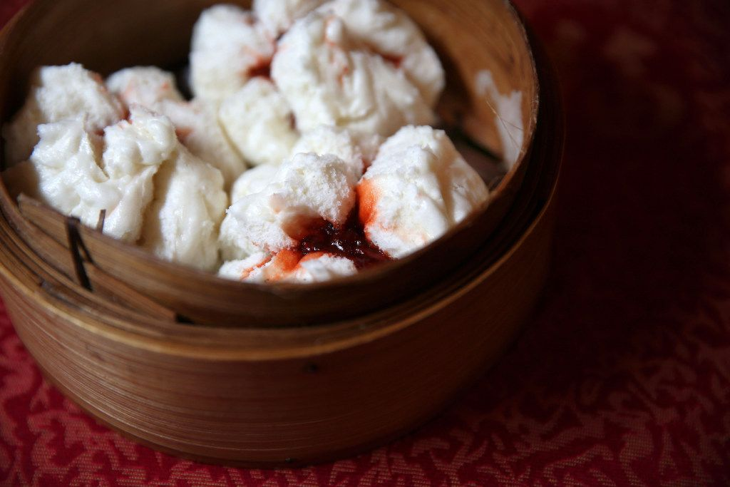 Char siu bao (steamed pork buns) at Kirin Court. They're filled with chopped pork in a sweet sauce. Look for fluffy, warm buns generously filled with a saucy, meaty delicious barbecue pork filling.