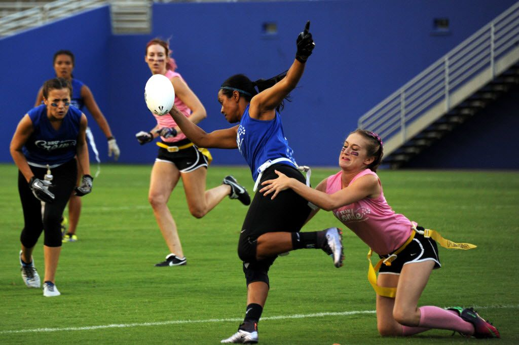Vanita Krouch runs with the ball at Blondes vs. Brunettes powder puff game at Cotton Bowl in Dallas on Aug. 13, 2016.