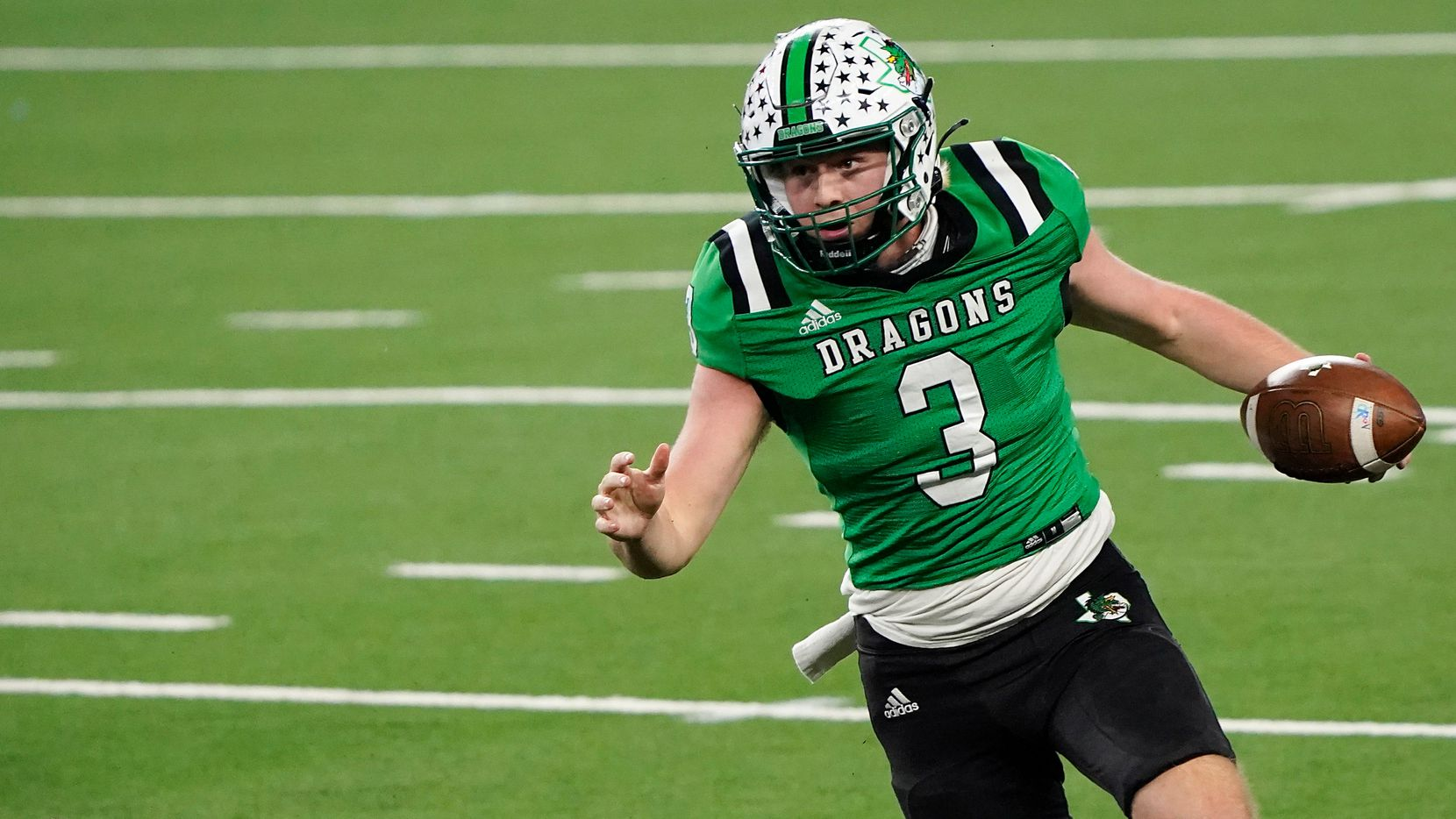 Southlake Carroll quarterback Quinn Ewers (3) gets past Austin Westlake linebacker Nicholas Morris (13) during the fourth quarter of the Class 6A Division I state football championship game at AT&T Stadium on Saturday, Jan. 16, 2021, in Arlington, Texas. Westlake won the game 52-34.